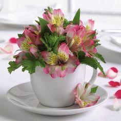 adorable table centerpiece idea - use brightly colored teacups
