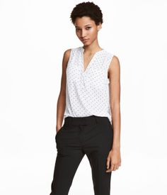 White/dotted. CONSCIOUS. Sleeveless top in a patterned crêpe weave with a V-neck, buttons at the top and gathered yoke at the back. Two chest pockets and a