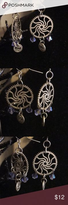 "Gear Swarovski crystal earrings handmade Earrings are made with gears and lavender Swarovski crystals on fish hook earwires  Earrings measure 1""  I designed and crafted these earrings in my Home studio  Earrings are one of a kind. I believe each piece of jewelry be as unique as the woman wearing it   Earrings will arrive in an organza pouch ready to be given as a gift or as a gift for yourself   Free earrings with any jewelry purchase   Thanks for checking out my closet! Jewelry Earrings"