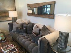 Love this wood/mirror detail.