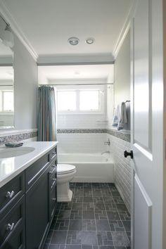 Tiny hall bath, subway tile, dark floors, dark vanity. Classic and dramatic. Use for hall b'rm. #smallbathroomrenovations