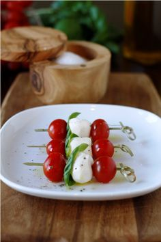 caprese on a skewer is the perfect Summer party food. Drizzle with reduced Balsamic vinegar, olive oil and some s & p.