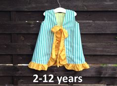 This open back a-line dress sewing pattern will give you an adorable little dress for your baby girl or toddler sizes 2-12 years.