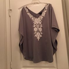 Grey top with Lace detail Lane Bryant size 22/24 Grey V-neck batwing top with lace and beaded details Lane Bryant Tops Blouses