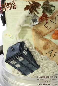 Closeup on the most insane/awesome wedding cake in all of creation. Harry Potter. Firefly. Game of Thrones. Hunger Games, Doctor Who, How to Train Your Dragon, and His Dark Materials. Absolutely amazing. I would of course swap a few of these with other awesomeness. I love the dr who part!