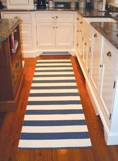 hallway or bathroom rug..  momma click on this one it has a bunch of cute blue things