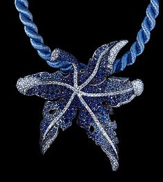 Fall pendant by Mousson. Sapphires and diamonds in white gold.