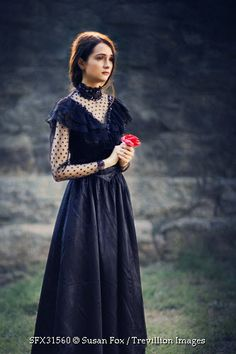Trevillion Images - sad-victorian-woman-with-rose