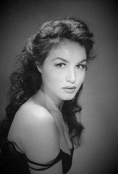 Julia Chalene Newmeyer (Chalane was her mother's maiden name) was born on August 16, 1933 in Los Angeles,California. Her father was a one-time professional football player (LA Buccaneers, 1926), her mother was a star of the Follies of 1920. From an early age, Julie studied piano, dance and classical ballet. She graduated from high school at the age of 15, and spent a year touring Europe with her mother and brother. Julie became prima ballerina for the Los Angeles Opera.