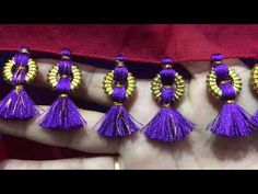 Hi Friends In this video, We have shown How to make saree kuchu design using Ring shape beads. This design very well suitable for Silk Sarees and Cotton silk. Saree Tassels Designs, Saree Kuchu Designs, Fancy Blouse Designs, Blouse Neck Designs, Hand Embroidery Videos, Hand Embroidery Stitches, Smocking Patterns, Wedding Silk Saree, Sewing Stitches