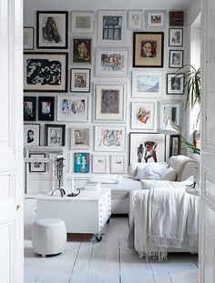 I love a white room, especially floors.  But I also like these pics and the way they have different colored frames but almost all the same mat.