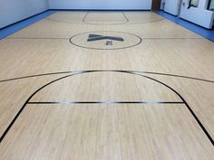 Tarkett Sports Omnisports 5.0 and Tarkolay slip-sheet installed in April of 2015 in Vineland, NJ. Maple Design court with a Sky Blue border.