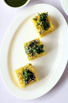 Dhokla recipe or khaman dhokla is a quick, gluten-free, healthy, steamed Gujarati snack made with besan. How to make dhokla in cooker step by step method Indian Snacks, Indian Food Recipes, Ethnic Recipes, Lunch Recipes, Breakfast Recipes, Vegetarian Recipes, Khaman Dhokla, Dhokla Recipe, Food Porn