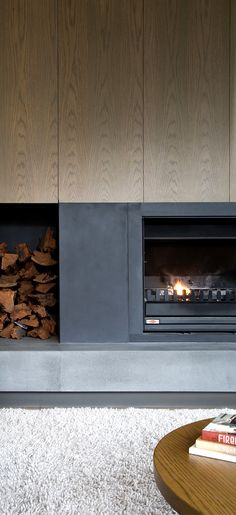 wood burning fireplace with wood storage Fireplace Feature Wall, Tv Over Fireplace, Fireplace Hearth, Home Fireplace, Fireplace Surrounds, Fireplace Design, Joinery Details, Muebles Living, Minimalist Living