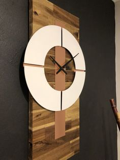 Gorgeous Acacia timber with a genuine copper trim. The clock can be hung either vertically or horizontally