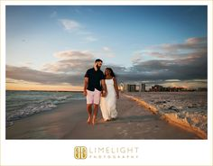 engagement session, bride and groom, beach, walking, walking along the beach, holding hands, laughing, smiling, sand, waves, ocean, sunset, blue skies, barefoot, Sand Key Park, Florida, white, navy blue, dress, sunshine, sweet, cute, Limelight Photography, www.stepintothelimelight.com