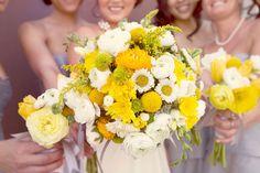 Yellow and white boquet w/ yellow & white ranunculus, craspedia, button mums, etc. I LOVE THIS!