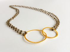This is the bijou necklace in smokey quartz and gold x