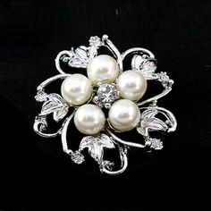 Buyinhouse New Fashion Ladies Girls Silver Plated Flashing Rhinestones Crystals Pearls Flower Petals Leaves Brooches Pin Clips All-match Clothing Accessories Suitable for Any Occasions Buyinhouse http://www.amazon.com/dp/B00JQU59KQ/ref=cm_sw_r_pi_dp_LXKKvb0VJP2V9