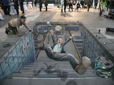 ooopppppssss he fell down !!!!!!!!!!!    A Street painting that looks like real one....
