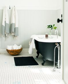 beadboard walls, subway tiles, coal-black tub, turkish towels and a little touch of greenery make for a perfect bathroom - Nickey Kehoe Estilo Interior, Interior Desing, Home Interior, Bathroom Interior, Eclectic Bathroom, Rental Bathroom, Bathroom Styling, Bad Inspiration, Bathroom Inspiration