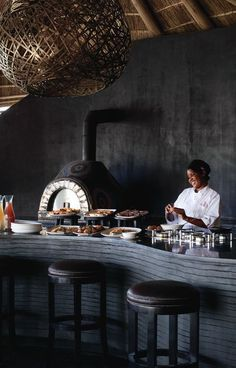 Belmond Eagle Island Lodge no doubt has absolute style - it even has homemade wood fired pizza, curtsy of the clay pizza oven. But the unanimous favourite, the Fish Eagle Bar, is perched at the tip of a peninsula - here you can enjoy a cocktail, some scrumptious bar food and stunning uninterrupted scenes, any time of day or night. Timbuktu Travel. Safari Food, Safari Holidays, Okavango Delta, Bar Food, Wood Fired Pizza, Boutique Hotels, In The Tree, African Safari, Lodges