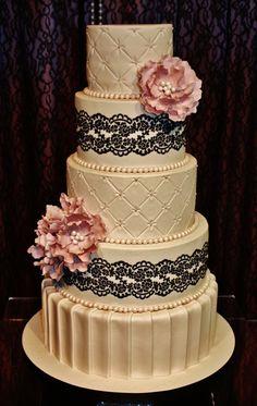 ivory wedding cake with black lace
