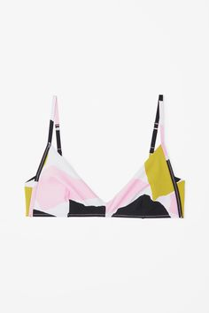 A soft-cup style, this bikini top is made from double-sided fabric with an all-over, colour-contrasting print. It is secured with adjustable straps and a hook clasp fastening on the back.