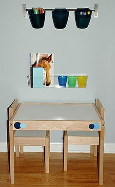 Kids craft center - includes a nice way to store paper roll for kids underneath the table...