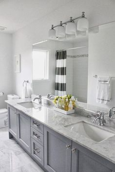 Master bath remodel - grey cabinets with carrera marble. Accents: yellow or navy? Grey Bathroom Cabinets, Gray And White Bathroom, Bathroom Renos, Main Bathroom, Bathroom Remodel Master, Bathroom Makeover, Grey Cabinets, Bathroom Design, Bathroom Decor