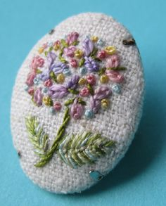 Art embroidery pink hydrangea button brooch. by MargDierEmbroideryOne of my favourite flowers , I love that hydrangeas have so may colours in their blooms. This flower has shades of pink, sky blue, yellow and lilac . The stitches I have used are french knots and lazy daisy stitch. The backing is a cream raw silk. height 3cms. Materials: silk, silver colour brooch back, thread, cotton, space dyed thread. $21.92 USD. Etsy