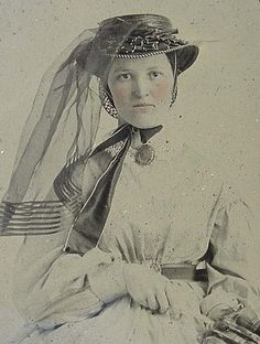 1860s hat and veil.  Such a fragile veil, and an interesting asymmetrical composition for the time period.