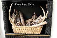Putting Christmas away without losing winter. LOVE the antlers with pinecones and a touch of silver.