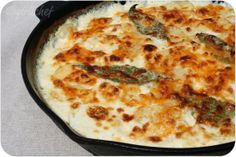 Cast Iron Cheesy Scalloped Potatoes (with a fresh bay leaves & nutmeg?  Ohhhhhh my!)