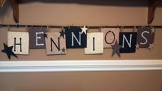 PRIMITIVE CRAFT Cardboard covered in paper and stencil names. Hang on inexpensive rod. Cuteee