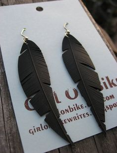 I have seen lots of ways to reuse old bike tires but this is the best one yet! I love the earrings!
