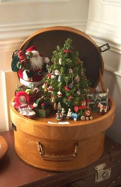 Love the miniature Christmas scene in vintage carrying case.