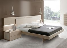 Nice modern bed with wooden headboard                                                                                                                                                           ..