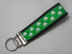 """Shamrock Key Chain, Key Fob, Wristlet Key Chain, Wristlet Key Fob, Irish Key Chain. Our Wristlet Key Chains are made using heavy duty cotton webbing. Ribbon is sewn on for added durability. The large loop is perfect for slipping your wrist through for hands free shopping. It also makes it easy to find in bags. Key Chain length is approximately 5"""" and fits most wrists. A perfect gift for that new driver, a special gift for someone or yourself!."""