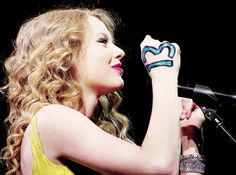 Taylor Swift's lucky number 13 on her hand... It is drawn on and I like drawing it on my hand also!