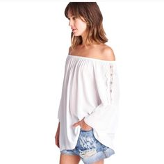 April Spirit Boho Top White off shoulder top w/Lace accent down bell sleeves. 95% Poly 5% Rayon. Loose fit. Too cute. Pair w/cut off jean shorts, palazzo pants & maxi skirts. 3rd pic(not actual top) shows off shoulder top paired with pants. Available sizes Small & Medium. April Spirit Tops Tunics