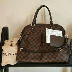 Louis Vuitton TREVI GM DAMIER EBENE Great, pre-loved condition. Don't worry about authenticity. Poshmark will verify for you. Comes with dust bag. USE THE BUTTON TO MAKE YOUR OFFER. THANKS. Louis Vuitton Bags Shoulder Bags