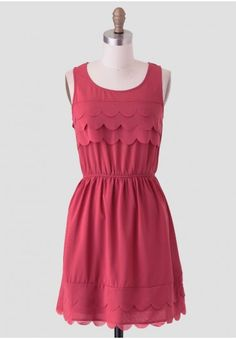 <p>Accented with scalloped details at the bust, this darling brick-red dress also features a tiered scalloped hemline for a charming touch. Finished with a keyhole opening at the back and an elastic waistline, this adorable frock can be accessorized with gold-toned jewelry and booties for a lunch date. Fully lined skirt.</p><p>100% Polyester<br /> Imported<br /> 33