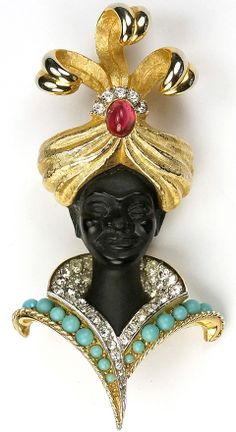 Blackamoor ~  gold plated base metal, rhinestones, enamelling, cabochon, faux turquoise Boucher   ~  1961.