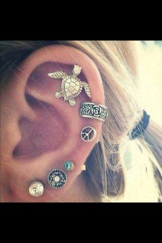 Piercings ♥ I love the turtle earing!