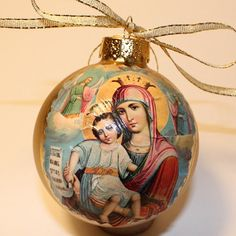 Virgin Mary and Child on a Gold Glass Ball Christmas Ornament. Handmade with a vintage retro look.