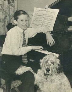 Glenn Gould at thirteen with his parakeet, Mozart, and his english setter Nicky.