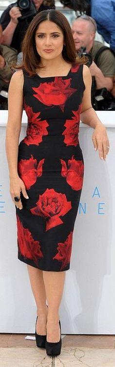 Salma Hayek: Dress – Alexander McQueen  Purse – Saint Laurent