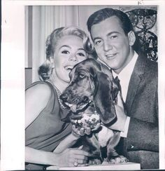 "Bobby Darin & Sandra Dee 1962 press photo - ""Candy Dandy: In Hollywood - Polly, selected by a movie studio as the champion candy eater to fill a film role requiring a sweet-toothed canine, poses with her co-stars Sandra Dee and Bobby Darin. Pollys part calls for her to eat bowls of assorted candies. Other dogs among the more than 100 tested for the part played favorites and wouldn't eat all kinds. Pollys favorite brand is peppermint but she eats all."""