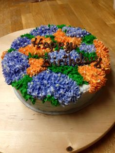 Hydrangea's in Orange and Blue adorn this Beautiful Birthday Cake